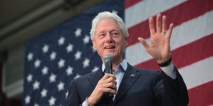 President Bill Clinton speaking in front of an American flag
