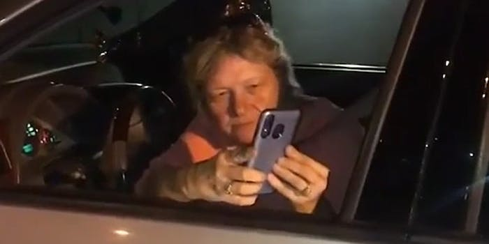 woman filming stranger from car