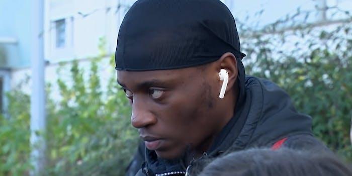 man staring intently wearing earpod