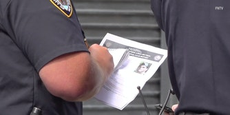 A document being held by an NYPD officer