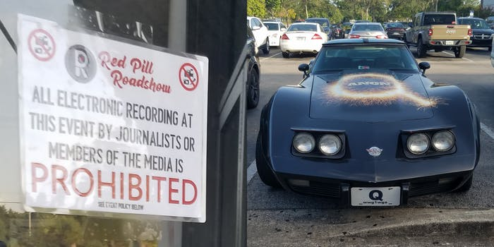 """red pill roadshow sign """"all electronic recording at this event by journalists or members of the media is prohibited"""" with corvette painted with Qanon logo on hood"""
