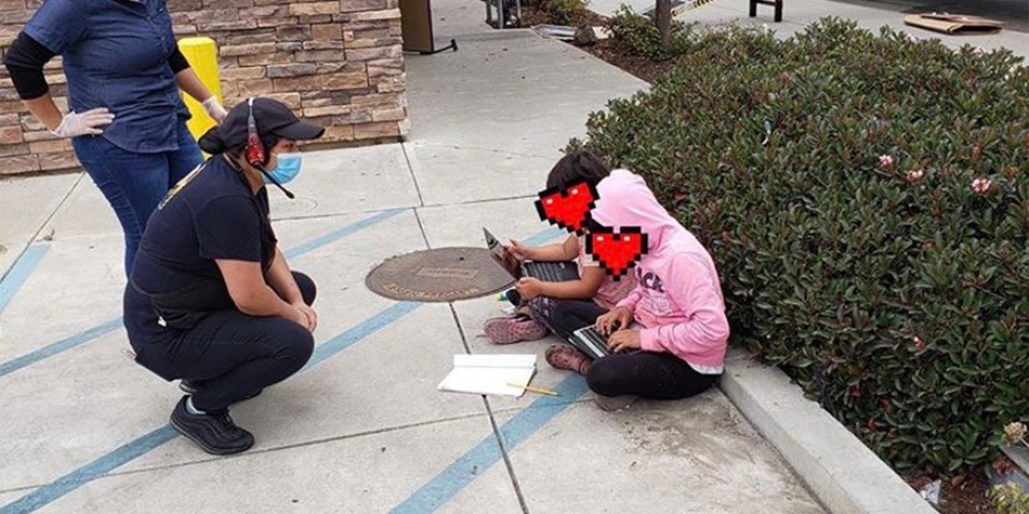 young girls sitting outside taco bell to use their wifi