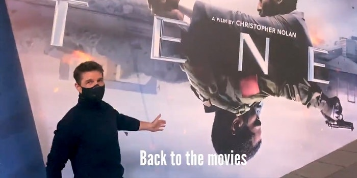 """tom cruise in front of Tenet movie poster with """"Back to the movies"""" subtitle"""