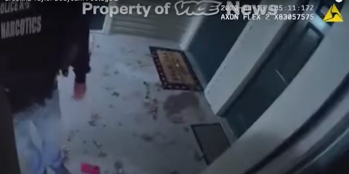 Bodycam footage shows an officer with a 'Narcotics' jacket standing on debris at Breonna Taylor's home