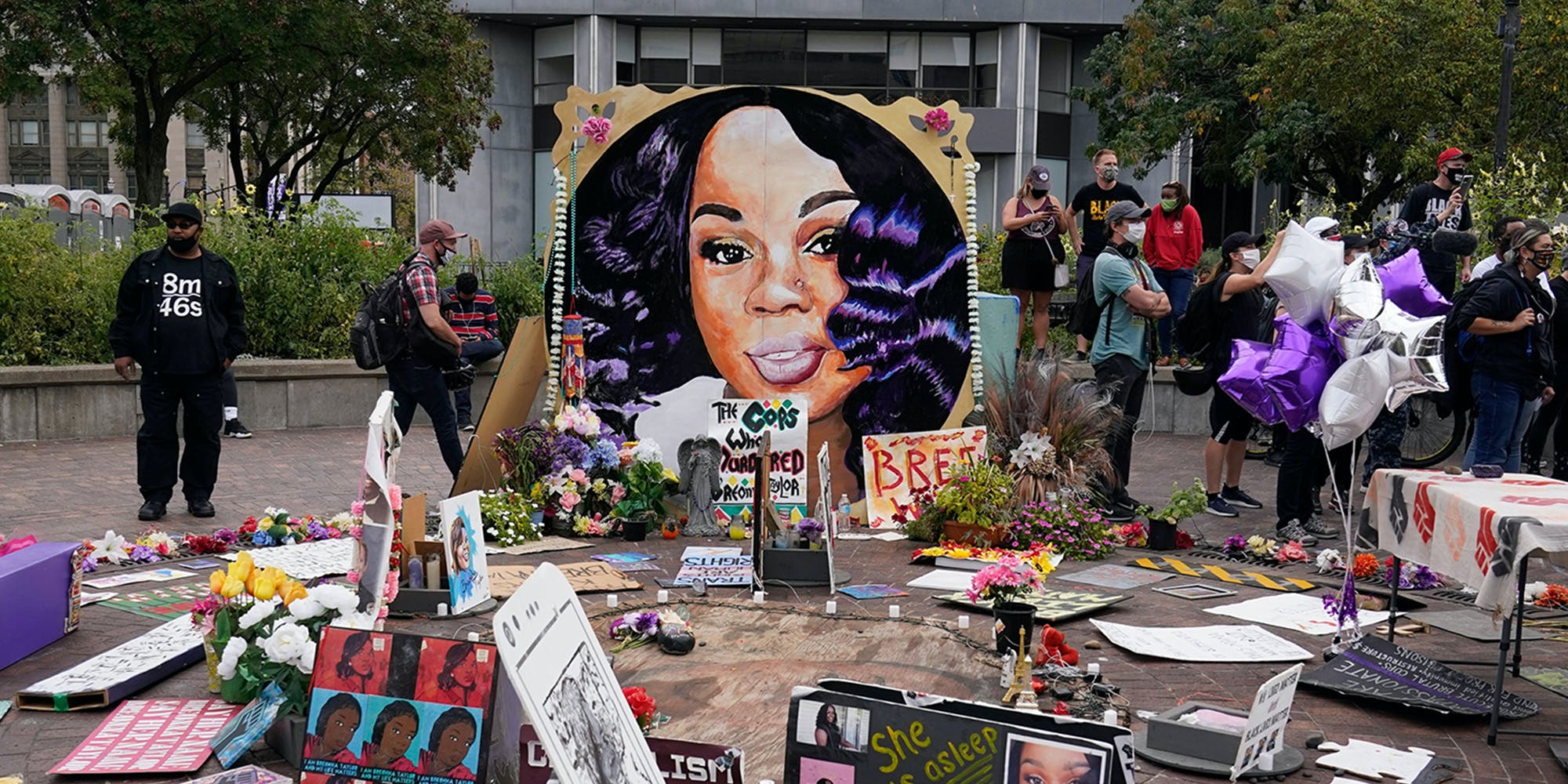 People gather in Jefferson Square around Breonna Taylor memorial