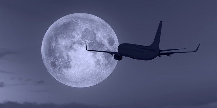 airplane with moon in background