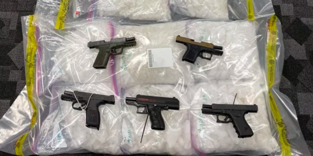 Firearms on top of bags of drugs