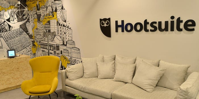 An office with the Hootsuite logo on the wall