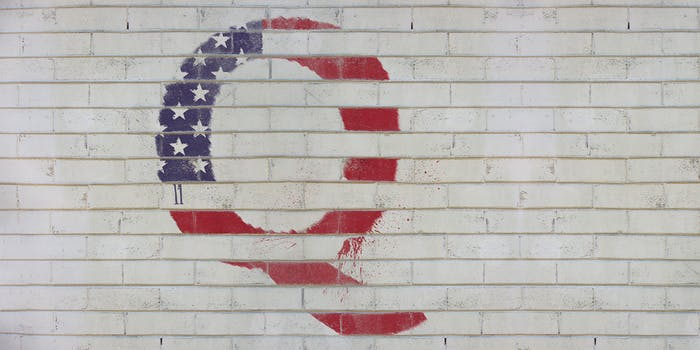 Q spray painted on wall in style of American flag