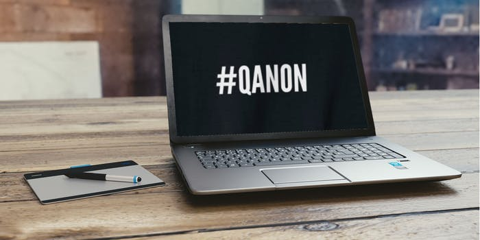 A laptop that says QANON on the screen