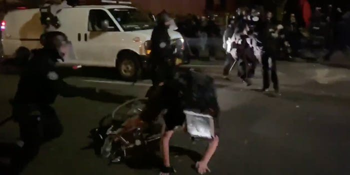 Police tackling an Uber employee off his bike