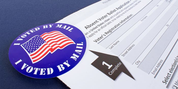 "absentee ballot with ""i voted by mail"" sticker"