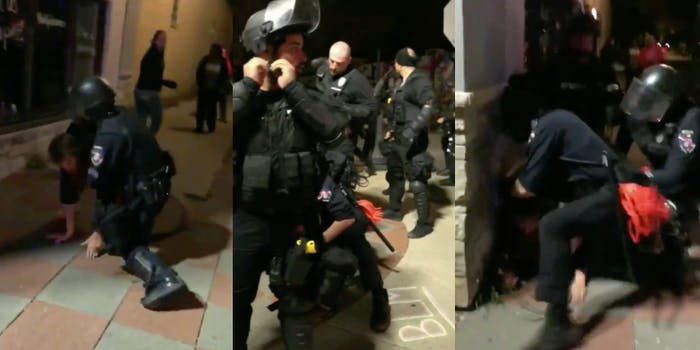 Cops in Wisconsin held a man down after pushing him to the ground