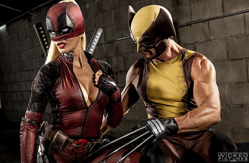 An image showing a woman dressed as a sexy Deadpool and a man dressed as Wolverine.