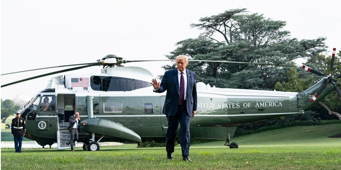 Donald Trump walking away from a helicopter
