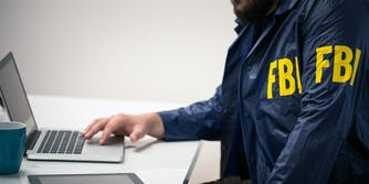 fake fbi agent on laptop