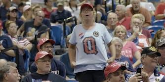 A woman wearing a QAnon t-shirt at a Trump rally