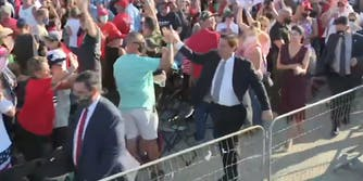 Ron DeSantis high fives people in crowd