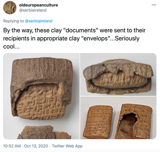 """By the way, these clay ""documents"" were sent to their recipients in appropriate clay ""envelops""...Seriously cool...""  picture of the tablets with their clay wrappers half cracked off to show the tablet inside"