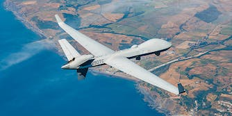 general atomics rebranded predator drone flies over coastline