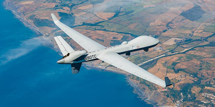 general atomics rebranded predator drone flies over coastline
