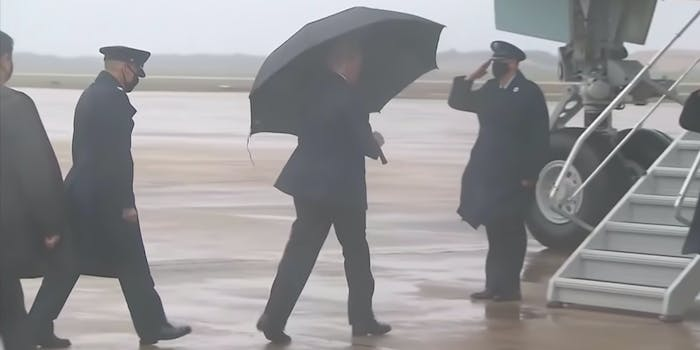trump umbrella no mask photo