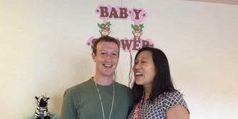Mark Zuckerberg and his wife at a baby shower