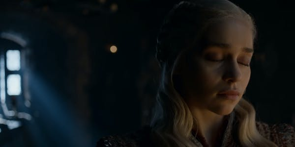 Image of Daenerys standing in a dark room with her eyes closed - fans of this character will love the Frozen Fire Game of Thrones fanfiction