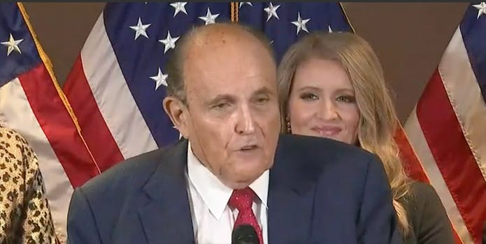 Hair dye appears to drip down Guiliani's face at presser