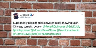 a tweet over a brick wall