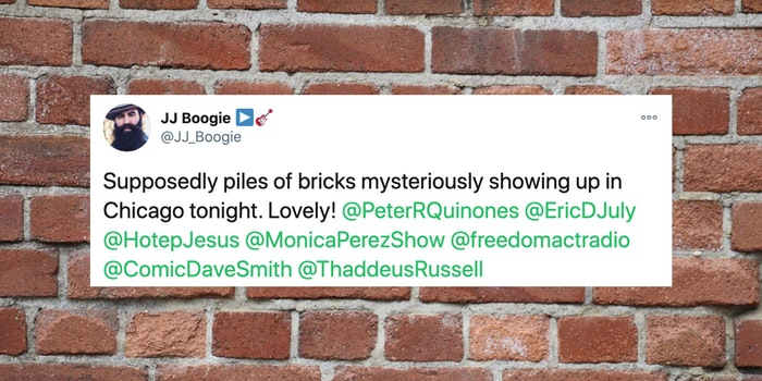 a tweet over a brick wall