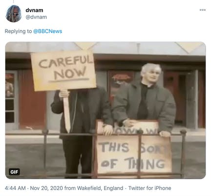 screenshot from Father Ted showing the two priests holding placards saying 'careful now' and 'down with this sort of thing'