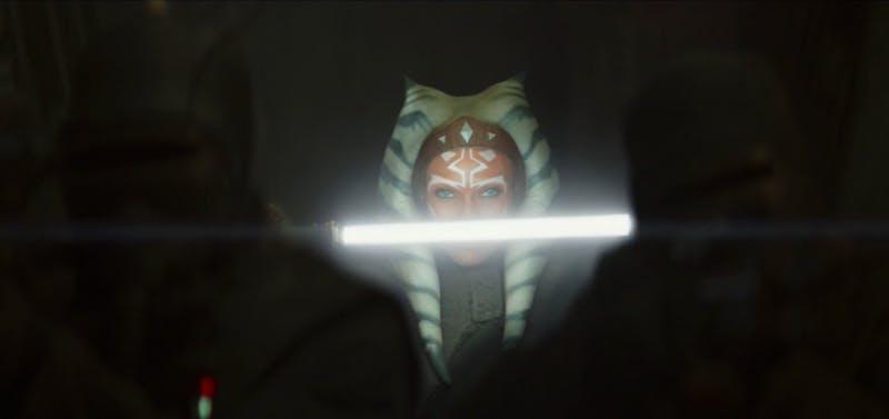 Ahsoka holds a lightsaber in the mandalorian
