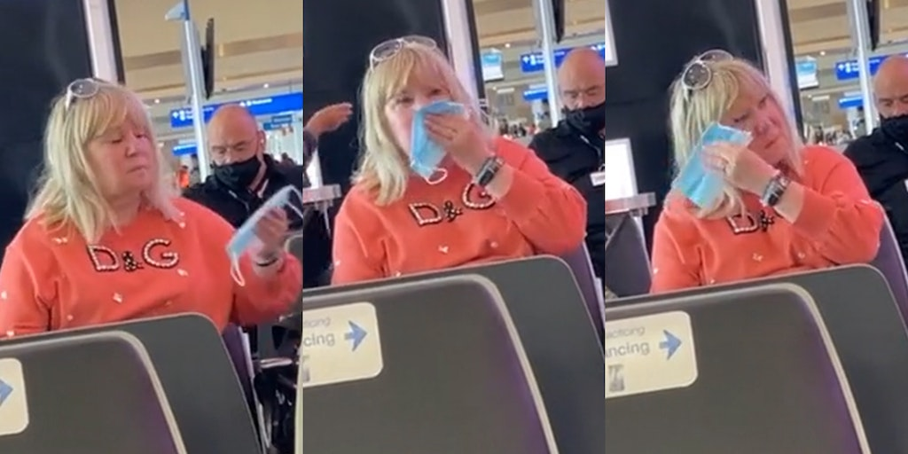 woman wiping nose with mask