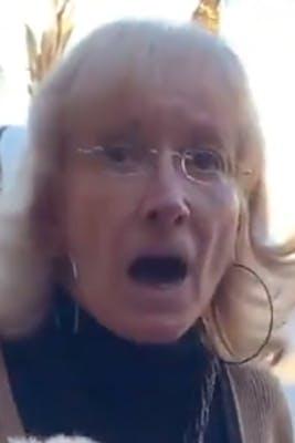 elderly woman with large hoop earrings