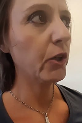woman with heavy makeup at dmv without a mask