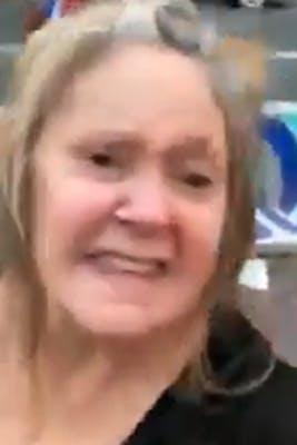woman sneers at camera
