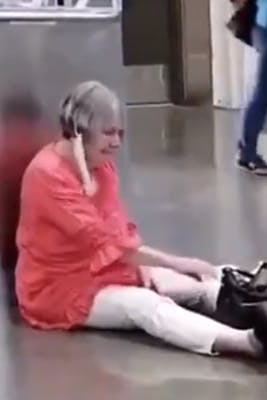 maskless woman sits on floor in costco