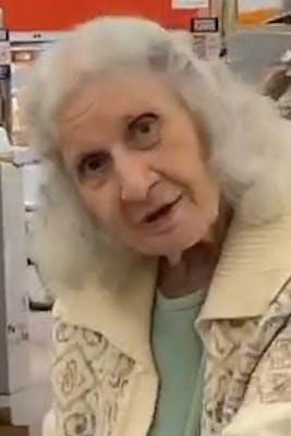 elderly woman in a sweater