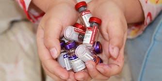 person holding vials of coronavirus vaccine