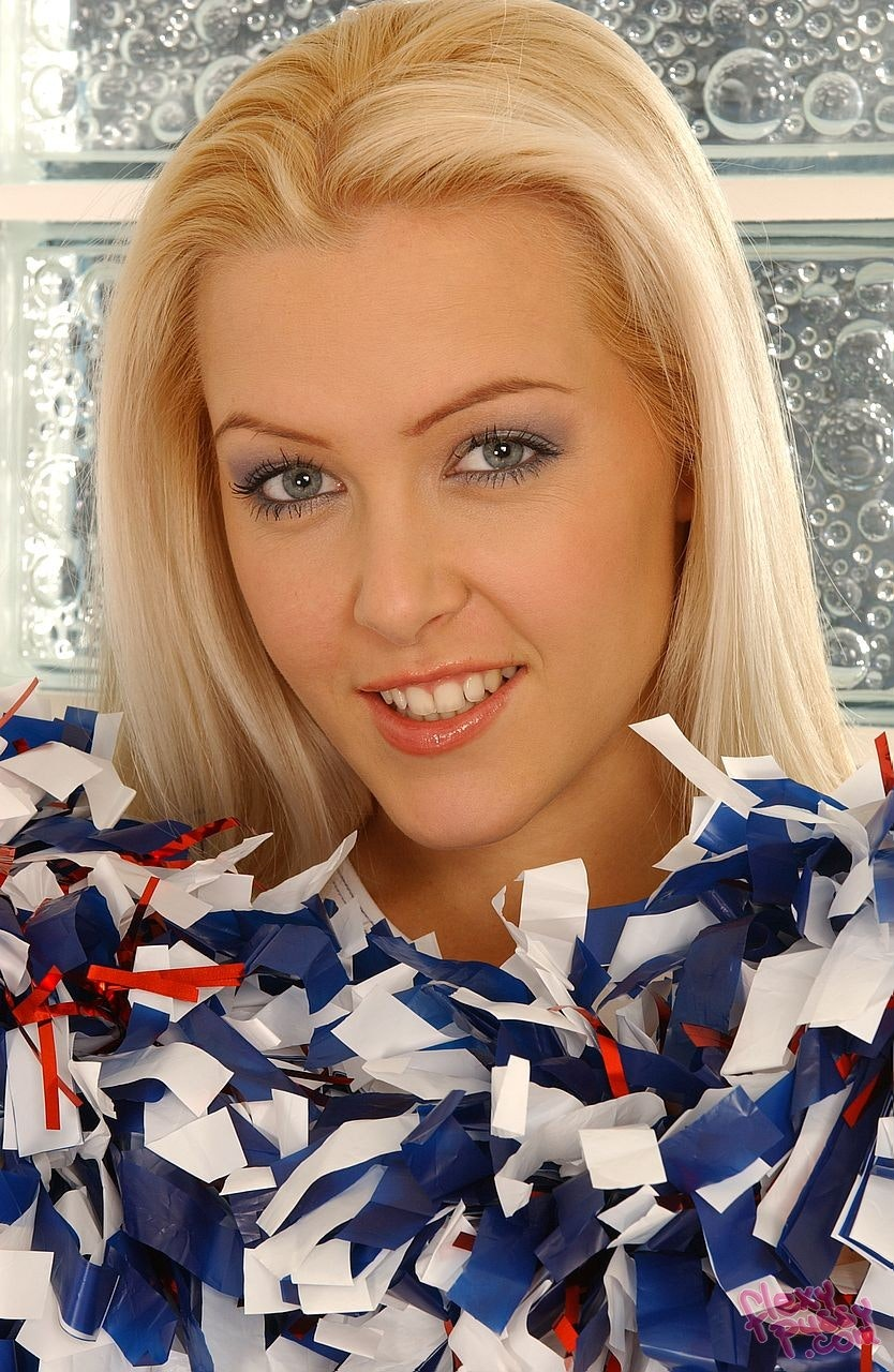 Close up of Sophie Moone smiling with her pom poms.