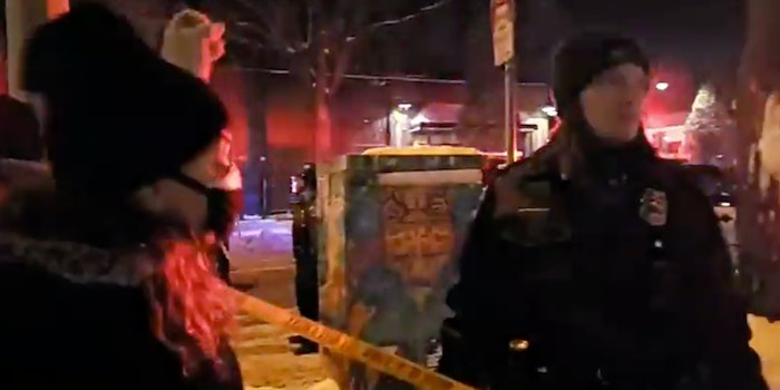 cop spits at Minneapolis protester