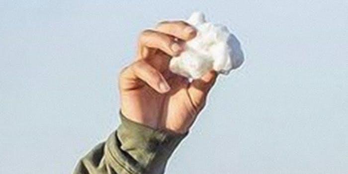 man holding bit of cotton