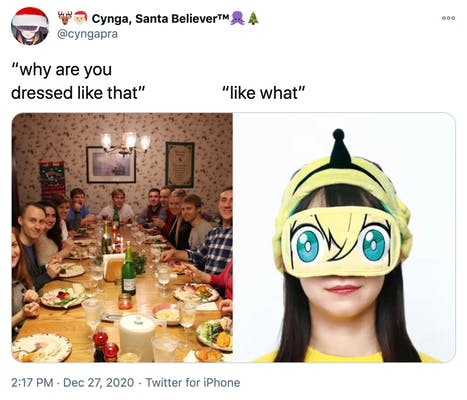 """""""why are you dressed like that? like what?"""" a photograph of a white family around a Christmas dinner table all looking at the camera with surprised expressions and  a dark haired pale skinned woman in a yellow anime eye mask with an odd black bowling skittle like device on top of her head"""