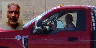A man in a red truck that conspiracy theorists believe is Jeffrey Epstein