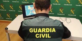 guardia civil officer on computer