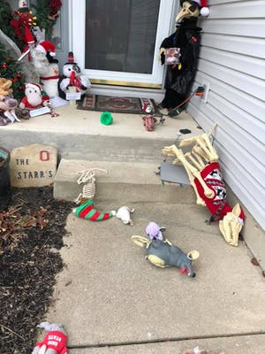 The dog skeleton and the rats from the porch display have been thrown around over the path in leading up to the porch