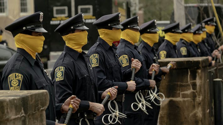 watchmen police officers in yellow masks