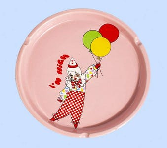 """Valfre's ceramic pink ashtray with a clown and the words """"i'm high"""" painted on it."""