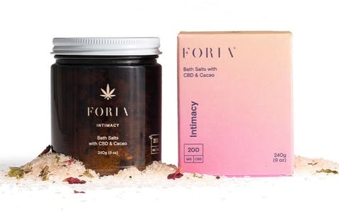 Foria CBD bath salts scattered around its packaging show how luxurious Foria products are.